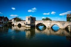 Ancient packhorse bridge. Ancient stone packhorse bridge over a main river beneath a sunny sky Royalty Free Stock Photo
