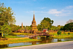 Ancient pagoda in Ayutthaya with lake. Ancient pagoda in Ayutthaya, Thailand with lake in foreground Royalty Free Stock Photo