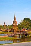 Ancient pagoda in Ayutthaya with lake vertical Royalty Free Stock Image
