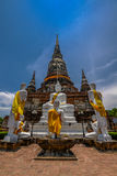 Ancient Pagoda with Buddha Image and Monk Statue Royalty Free Stock Images