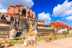 Ancient pagoda and buddha statue at Wat Chedi Luang temple in Chiang Mai, Thailand Royalty Free Stock Photo