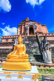 Ancient pagoda and buddha statue at Wat Chedi Luang temple in Chiang Mai, Thailand Stock Photography