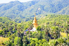 Ancient pagoda in burmese landscape in Bagan Stock Photography