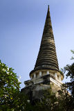 Ancient pagoda coming out of the jungle, thailand. Temples and pagodas in Ayutthaia, ancient capital of Thai kingdoms, near Bagkok Royalty Free Stock Photo