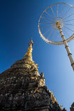 Ancient pagoda. And golden umbrella on beautiful gradient blue sky Royalty Free Stock Photos