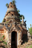 Ancient pagoda in Indein. Ancient Stupas at Indein overgrown with plants, Inle Lake, Myanmar Royalty Free Stock Photography