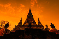 Ancient pagoda at the temple with sunset sky, Thailand Royalty Free Stock Image