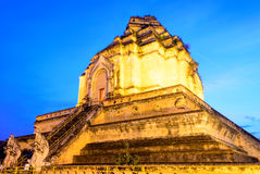 Ancient Pagoda of Thai Buddhist Temple in Twilight Royalty Free Stock Photo