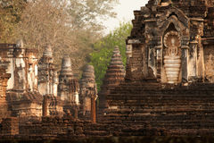Ancient pagoda in Wat  Jed Yod in Si Satchanalai historical park Stock Photo