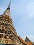 Ancient pagoda with Wat Pho on the background Stock Image