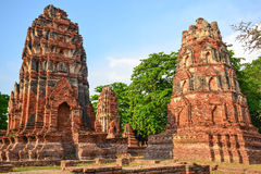 Ancient pagodas in Ayutthaya. Two ancient pagodas in strong daylight Royalty Free Stock Photography