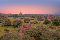 Ancient pagodas in the countryside from Bagan in Myanmar Stock Images