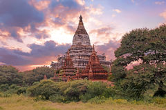 Ancient pagodas in the countryside from Bagan in Myanmar at suns Stock Photo
