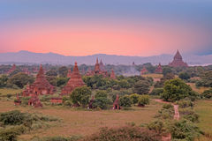 Ancient pagodas in the countryside from Bagan in Myanmar at suns Royalty Free Stock Images