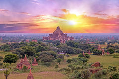 Ancient pagodas in the landscape from Bagan in Myanmar at sunrise Stock Photo