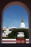 Ancient pagodas in an old temple with round arch foreground. Royalty Free Stock Image