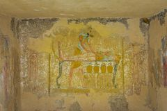 Ancient Painting of the egyptian god Anubis, balming a dead body royalty free stock photo