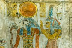 Ancient Painting of the egyptian god Ra and Maat in a tomb. Paintings of the egyptian god Ra and Maat in KV 14, the tomb of Tausert and Setnakht in the valley of royalty free stock photos