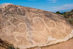 Ancient paintings, petroglyphs on the rocks near the Issyk-Kul, Stock Image