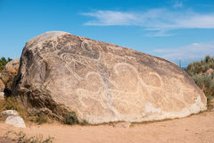 Ancient paintings, petroglyphs on the rocks near the Issyk-Kul, Stock Photos