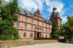 Ancient palace Johannisburg, Aschaffenburg, Germany. Against the background of  cloudy blue sky, view from the outside,  main entrance Royalty Free Stock Photography