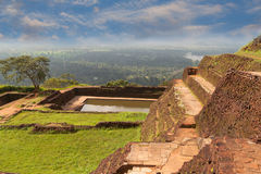 Ancient palace of Sigiriya in Sri Lanka. Against background of bright sunny day royalty free stock photo