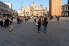 Ancient palace and tourists in Piazza San Marco in Venice, Italy Royalty Free Stock Photo