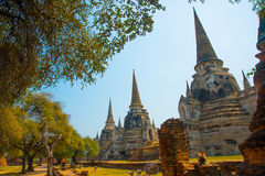 Ancient palaces. Ayutthaya Thailand. Ancient stone architectural structures on the background of blue sky, which are located in Ayutthaya, in Thailand Stock Photos