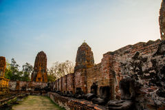 Ancient palaces on the background of blue sky. Ayutthaya Thailand. Stock Photos