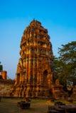 Ancient palaces on the background at sunset. Ayutthaya Thailand. Stock Photos
