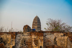 Ancient palaces on the background at sunset. Ayutthaya Thailand. Royalty Free Stock Photos