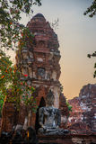 Ancient palaces on the background at sunset. Ayutthaya Thailand. Stock Photography