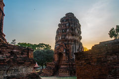 Ancient palaces on the background at sunset. Ayutthaya Thailand. Royalty Free Stock Photo