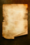 Ancient paper. With curl on wooden table close up stock photography