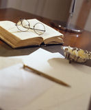 Ancient paper and book on antique wooden table Royalty Free Stock Photography