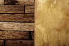 Ancient paper on a brown wooden surface. Stock Images