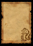 Ancient parchment with the image of a dragon Royalty Free Stock Photos