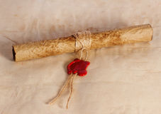 Ancient parchment scroll. With wax seal and twine Royalty Free Stock Image