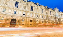 Ancient Paris building with car light trails, France.  Royalty Free Stock Photos