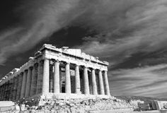 Ancient Parthenon in Acropolis Athens Greece. Black and white facade of ancient temple Parthenon in Acropolis Athens Greece on the cloudy sky background Stock Photo
