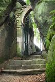 Ancient passage. Medieval portal hidden in woods Stock Photography