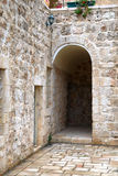 Ancient patio. Arch input in an ancient court yard in an old city of Jerusalem Royalty Free Stock Photography