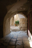 Ancient patio. Arch input in an ancient court yard in an old city of Jerusalem Royalty Free Stock Photos