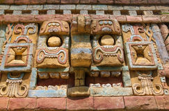 Ancient maya art wall pattern. Ancient brick art wall of the Maya. Stone carving with a maya chief Stock Photo