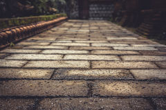 Ancient pavement leading into the distance with vanishing point as ancient background in vintage style Stock Images