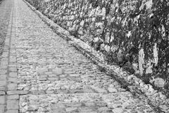 Ancient pavement and old stone wall Royalty Free Stock Photos