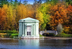 Ancient pavilion and the bridge in palace park. Gatchina. Petersburg. Russia. Stock Image