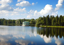 Ancient pavilion on  lake in palace park. Gatchina. Petersburg. Russia. Royalty Free Stock Photos