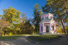 Ancient pavilion in old autumn park. Closer view of ancient pink pavilion in autumn park Royalty Free Stock Images