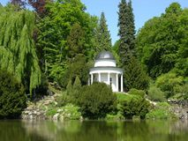 Ancient pavilion in a park scenery. Ancient pavilion in a magnificent park scenery Royalty Free Stock Photo
